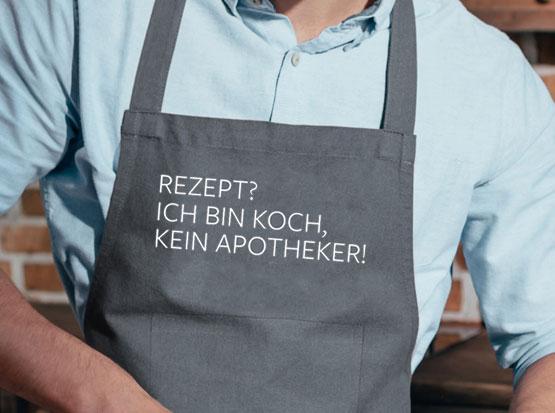 Grillschürze, grau, mit Spruch: Rezept? Ich bin Koch, kein Apotheker!